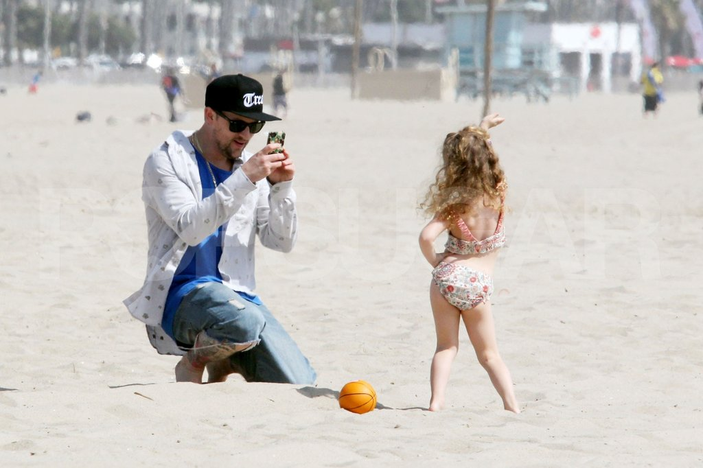 Harlow posed as dad Joel Madden captured an adorable moment on the beach in Malibu.