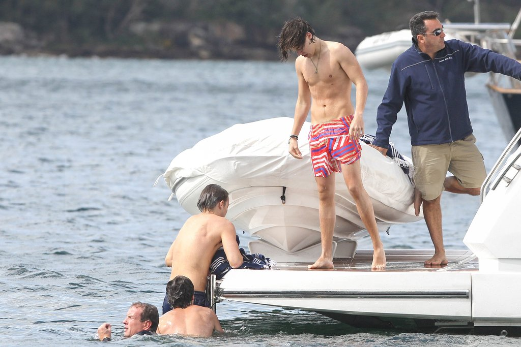 One Direction members spent their time in Australia boating and swimming.