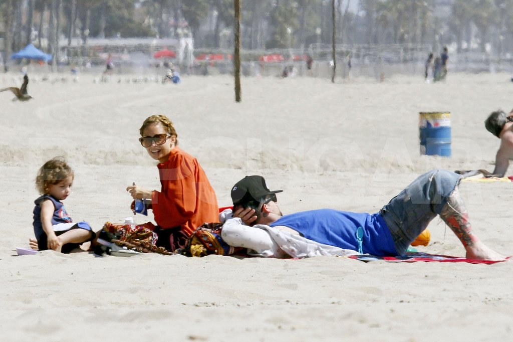 Joel Madden laid in the sand as Nicole Richie helped prep Sparrow for a day at the beach.