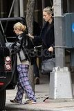 Ashley Olsen wore plaid printed pants and a leather jacket for a shopping date in the West Village with friend Leelee Sobieski.