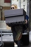 Mary-Kate Olsen out in NYC with two huge boxes.