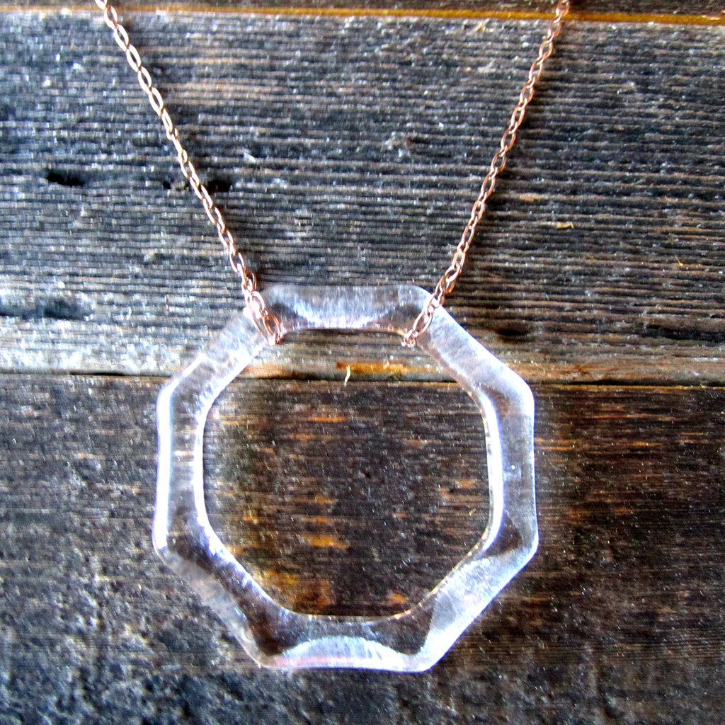 The octagonal-shaped necklace is repurposed from a St. Germain liqueur bottle, which was sourced from a local San Diego bar.  St. Germain Liqueur Necklace ($25)