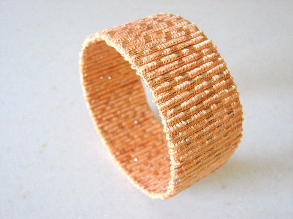 We couldn't believe this cuff was made from recycled cardboard tubing, leftover yarn, and Mod Podge glue! Shimmery Peach Bracelet ($6)
