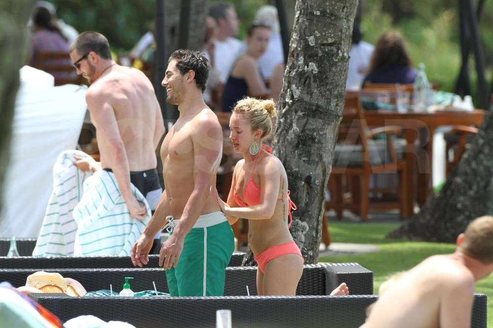 Hayden Panettiere helped her boyfriend, New York Jets wide receiver, Scotty McKnight, with some sunscreen in a bikini while vacationing in Hawaii.