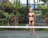 Hayden Panettiere hit tennis balls in a black bikini with boyfriend, New York Jets wide receiver, Scotty McKnight, in Hawaii.