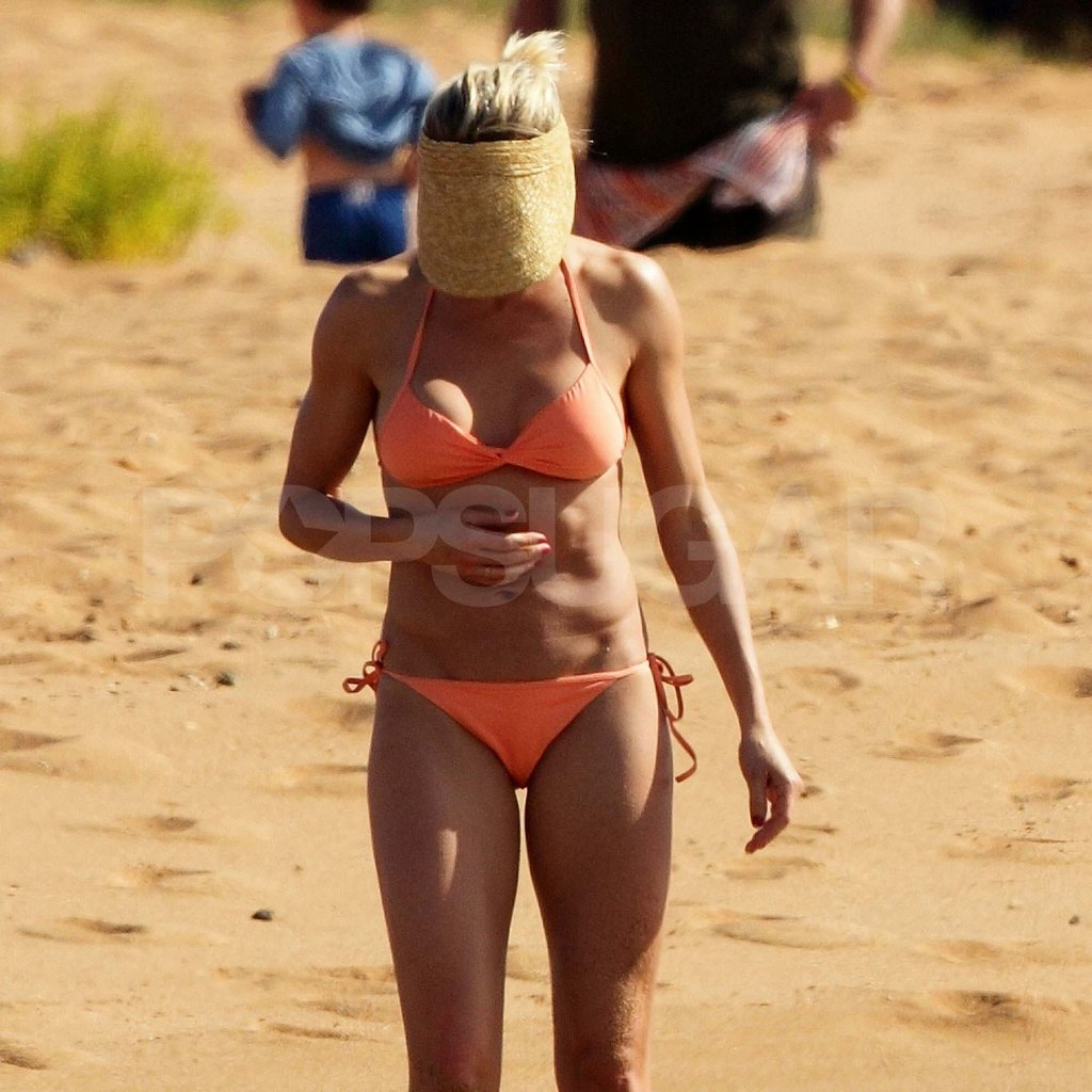 Cameron Diaz showed off her abs in a bright orange bikini on vacation with family in Hawaii.