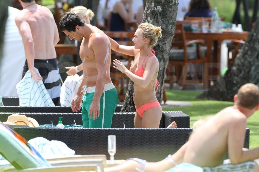 Hayden Panettiere took care of her boyfriend, New York Jets wide receiver, Scotty McKnight, by applying sunscreen to his back in a bikini while vacationing in Hawaii.