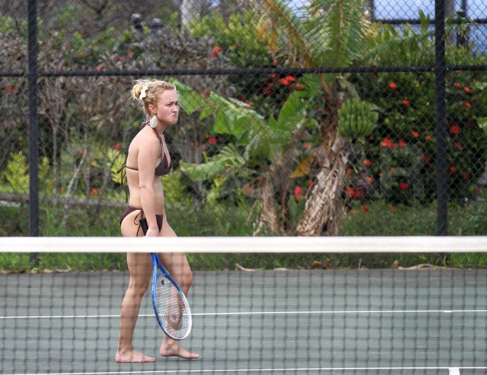 Hayden Panettiere wore a black bikini while playing tennis with boyfriend, New York Jets wide receiver, Scotty McKnight, in Hawaii.