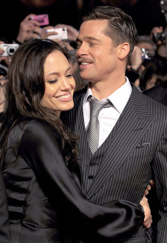 Angelina Jolie went in for a big hug at Brad Pitt's January 2009 Tokyo screening of The Curious Case of Benjamin Button.