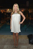 Kristin Cavallari hid her baby bump under a flowy white dress at the Condé Nast Traveler Hot List Party in LA.