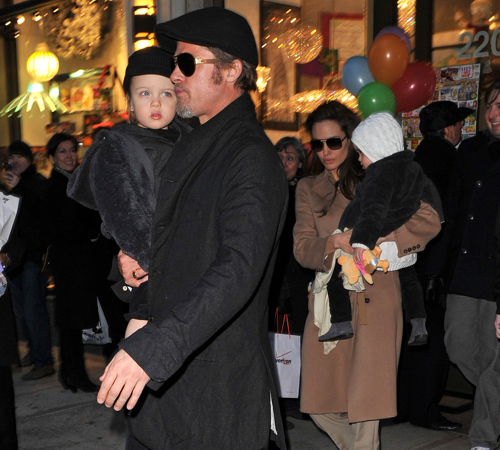 The Jolie-Pitts stopped by an NYC toy store during a December 2010 visit.