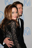 Brad Pitt put a loving arm around Angelina Jolie at the January 2012 Producers Guild Awards.