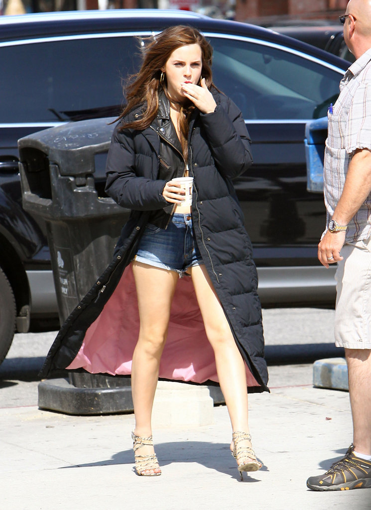 Emma Watson wore cutoff denim shorts with a puffy jacket on the set of The Bling Ring in Venice.