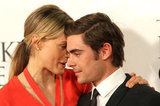 Zac Efron and Taylor Schilling shared a secret on the red carpet.