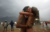 This pair smooched in the rain at the Chiemsee Reggae Summer music festival in Uebersee, southern Germany.