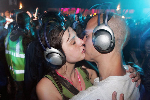 A couple in headphones smooched at the Glastonbury Music Festival in England.