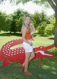 Teresa Palmer posed alongside Lacoste's signature crocodile at their Saturday pool party,