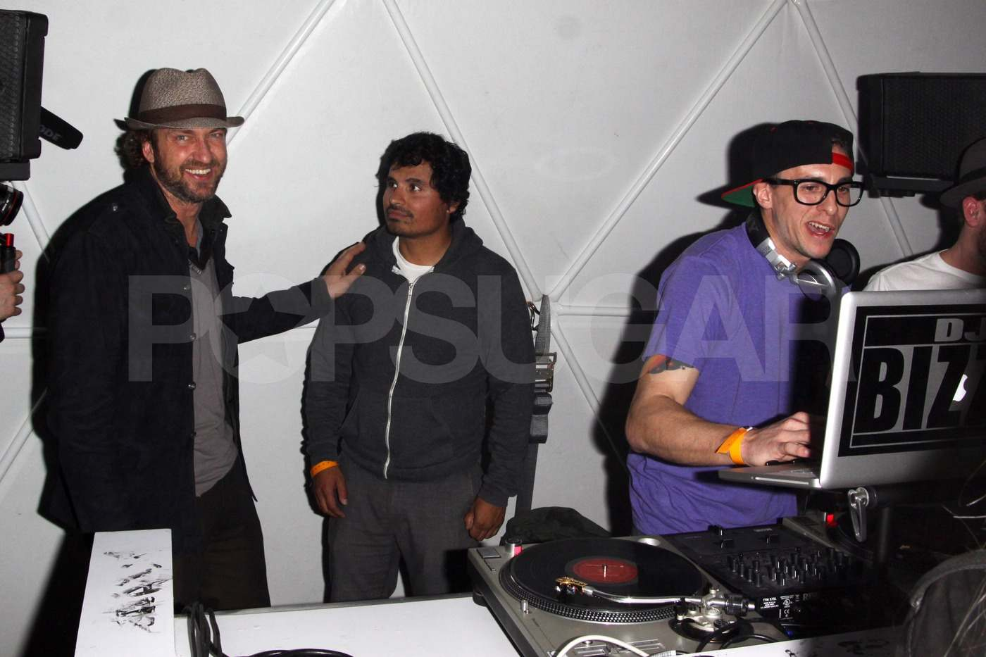 Gerard Butler stayed dry in an igloo during GenArt's Coachella afterparty on Friday.