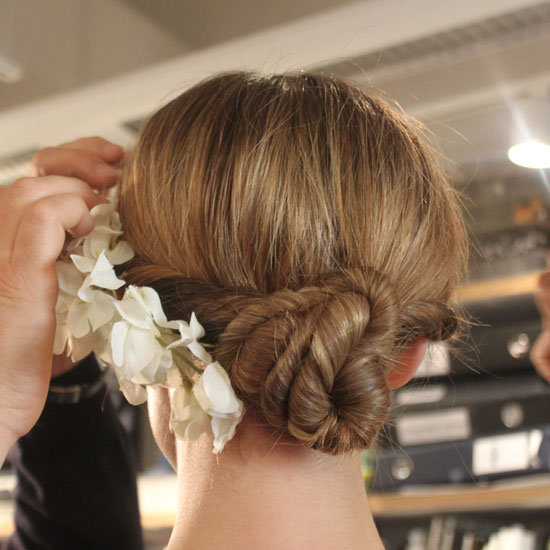 The Classic Bridal Bun Gets a Modern, Floral Twist