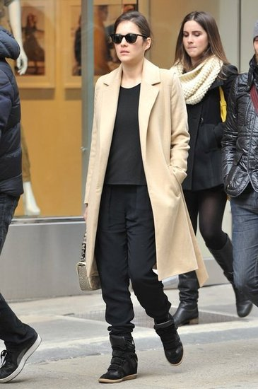 Marion Cotillard was spotted in NYC sporting a chic ensemble finished with a pair of Isabel Marant wedge sneakers.