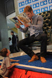 Chris Pine showed the pictures in the book he was reading.