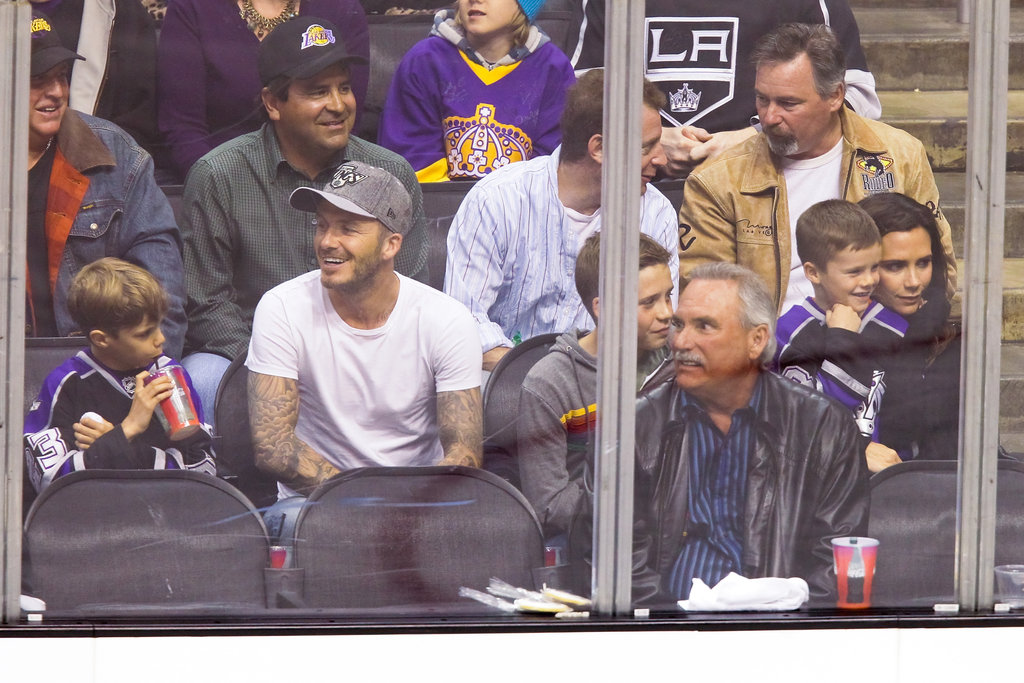 David Beckham and Victoria Beckham took their boys to a playoff hockey game between the Vancouver Canucks and the Los Angeles Kings at the Staples Center in LA.