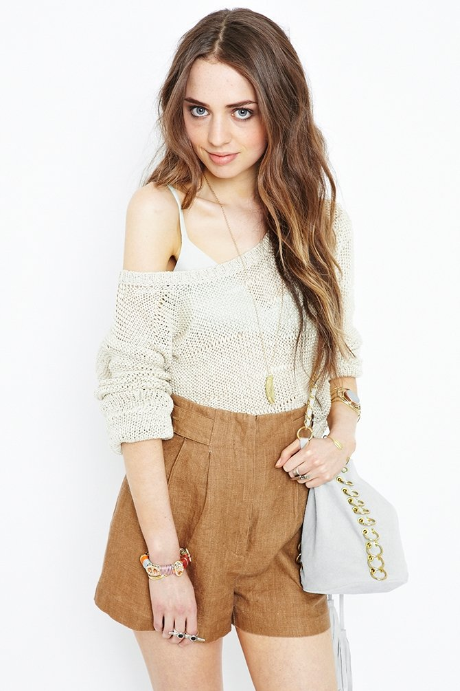 Pair these breezy linen shorts with a cute cropped top.  Nasty Gal Vintage Cute as a Button Linen Shorts ($98)