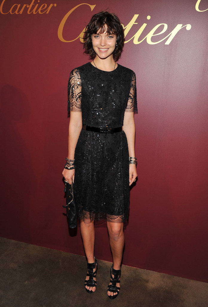 Arizona Muse looked sweet and sophisticated in a black cocktail dress with sheer sleeves.