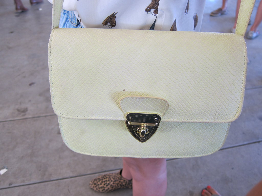 We love the pale yellow tint on this Topshop bag. The cross-body style is perfect for hands-free action.