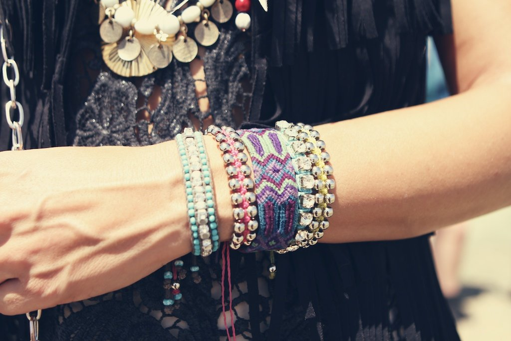 A colorful wrist arrangement — we're especially taken with the purple woven creation.