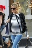 Sienna Miller filmed a commercial for the Amore Pacific skin care line on the streets of London while pregnant last Winter. Her striped shirt and ruffled sweater clearly emphasized her second-trimester bump.
