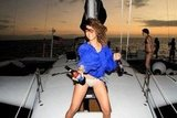Rihanna wore her bikini bottoms to drink beer on a boat.