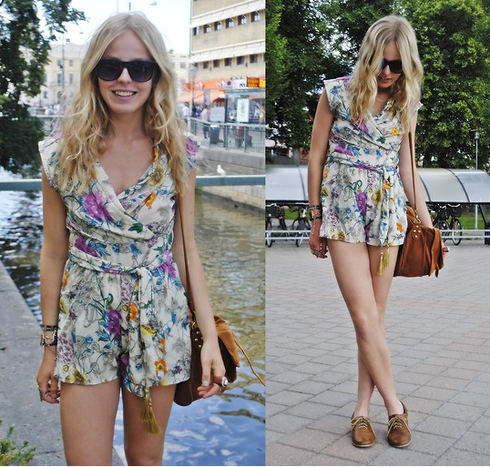 A floral romper like this is a sweet Summer staple. Just wear it the way you might a pretty blouse and shorts, and style with a pair of cool flats and your favorite bag for running errands.  Photo courtesy of Lookbook.nu