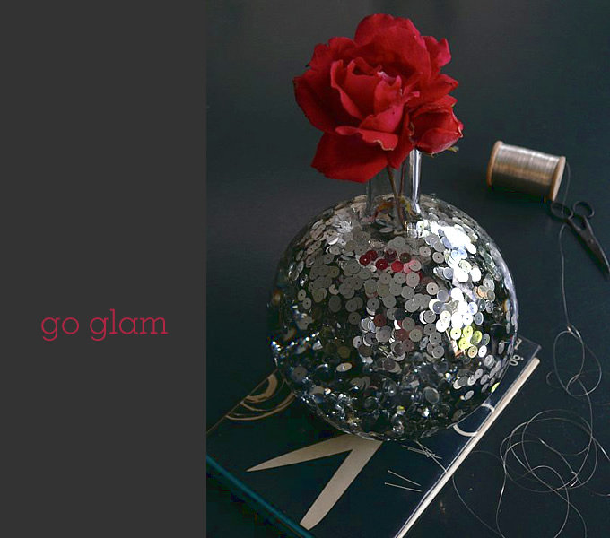 Add a touch of sparkle to an ordinary vase to glam up floral arrangements.  Source: Sania Pell at Home