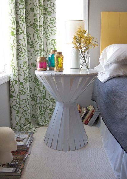 Use vinyl strips to add a shapely silhouette to a side table. Source: Apartment Therapy