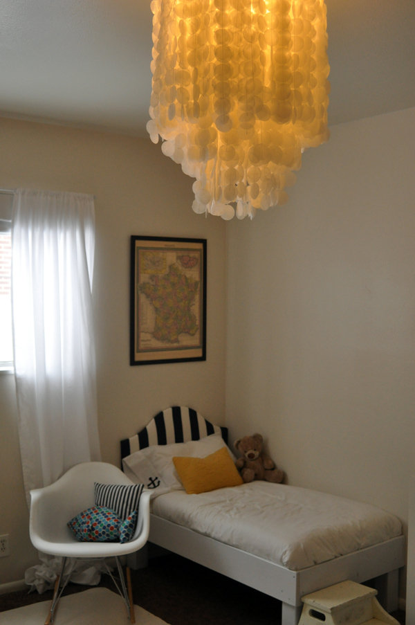 This beach-inspired chandelier is actually crafted from wax paper rather than shells!  Source: Freshly Picked