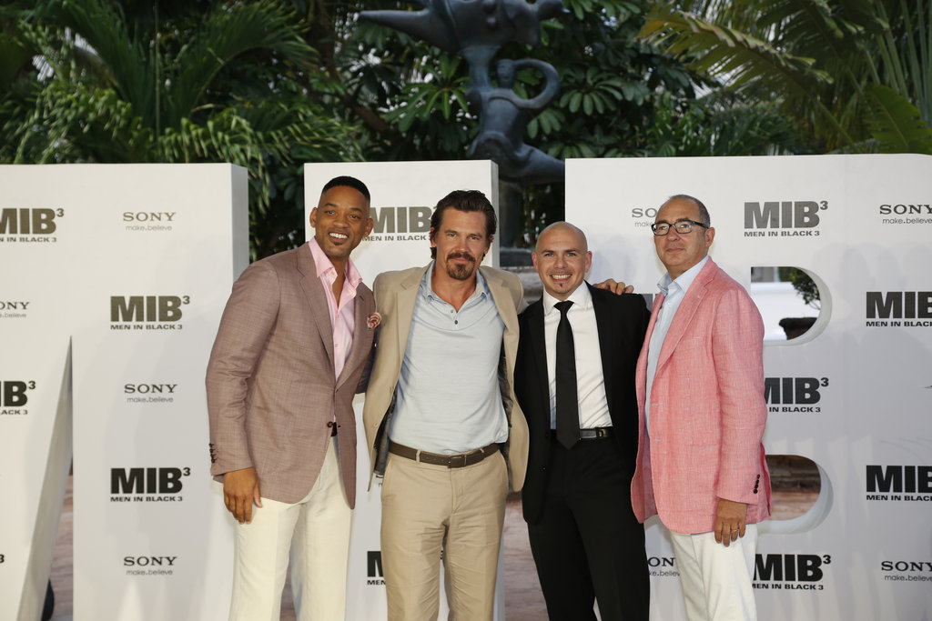 Will Smith, Josh Brolin, Pitbull, and producer Barry Sonnenfeld posed for a photo together at the Summer of Sony event in Cancun.