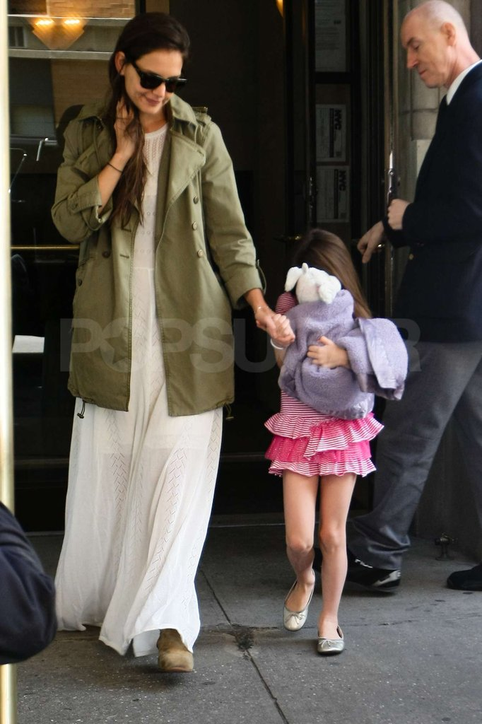 Katie Holmes holds Suri Cruise's hand as they leave their NYC apartment to celebrate Suri's 6th birthday!
