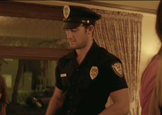 Alex Pettyfer poses as an officer of the law.