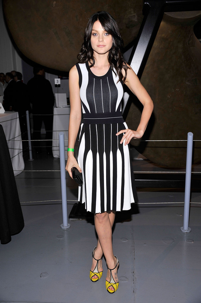 Jessica Stam lent a pop of color to her black and white dress with a pair of t-strap yellow pumps.