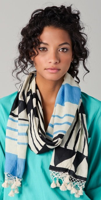 We can't think of a better way to layer up our breezy Spring look than with this colorful tasseled scarf. Madewell Tribal Stripe Scarf ($50)