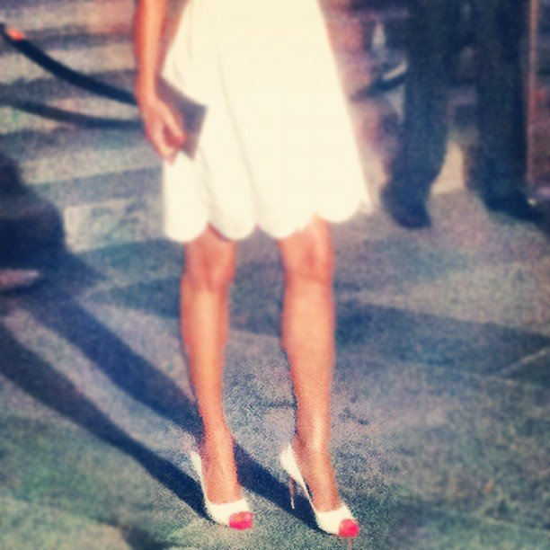 Here's a close-up of Helena Christensen's white peep-toe pumps — we love the neon pink lining.