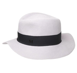 The black-white juxtaposition of this slick trilby hat reminds us of something straight out of Casablanca, and we're all for the romance of it. Maison Michel Andre Trilby ($505)
