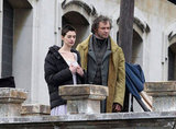 Anne Hathaway kept warm between takes with Hugh Jackman.
