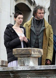 Anne Hathaway bundled up in between shots with Hugh Jackman.
