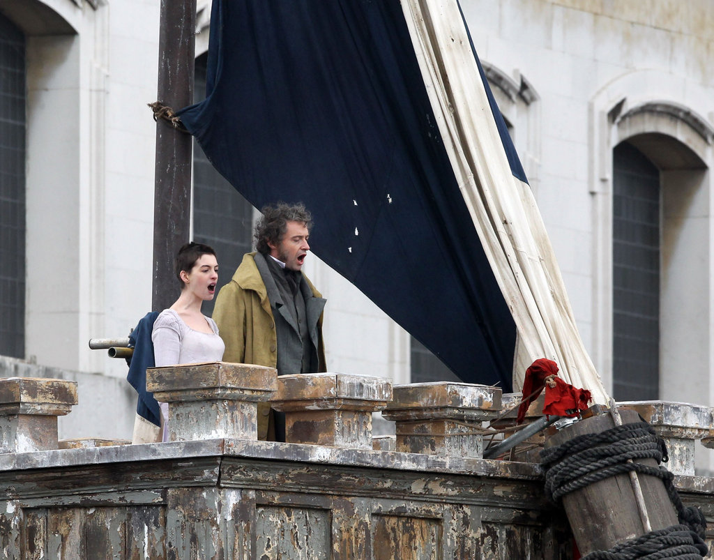Anne Hathaway and Hugh Jackman were in character on the Les Misérables set.
