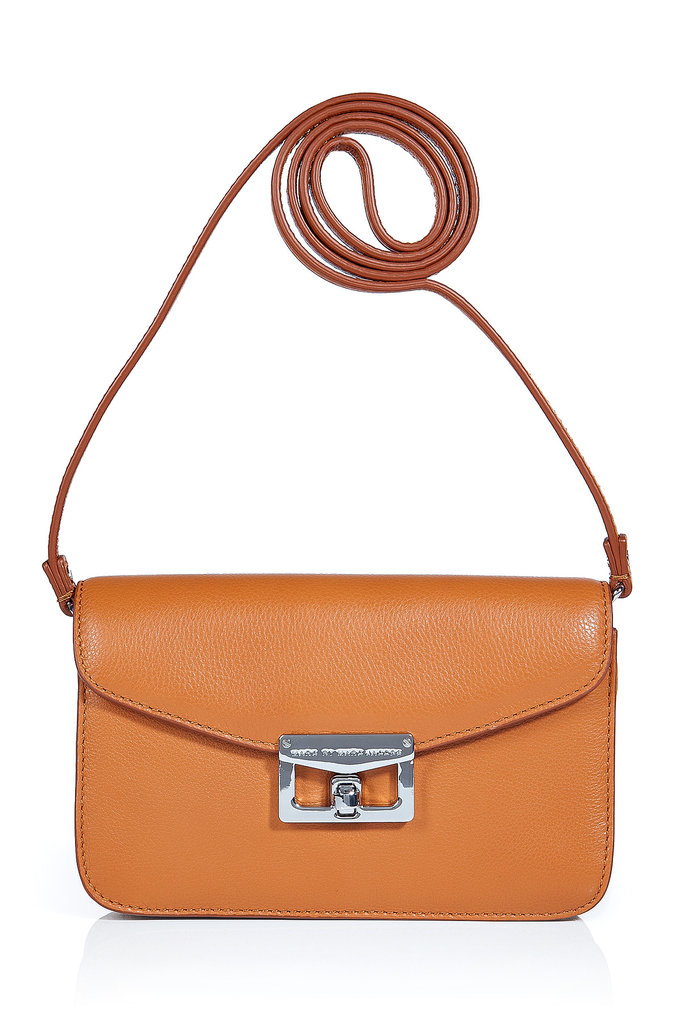 Functional, stylish, and sleek — the caramel brown color and classic silver-toned hardware achieve this bag's versatile wearability.  Marc by Marc Jacobs Caramel Cross Body Bag ($235)