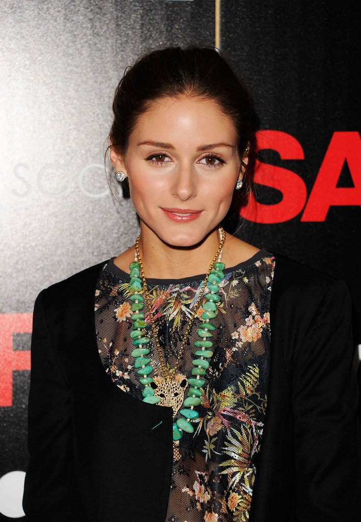 Olivia Palermo rocked a gorgeous green stone necklace over her floral outfit.
