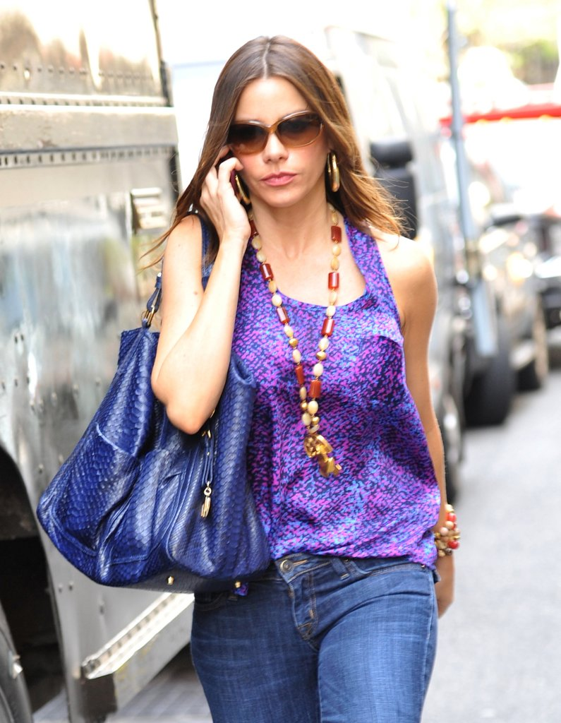Sofia Vergara dressed up a purple tank and jeans with a multicolored beaded necklace.
