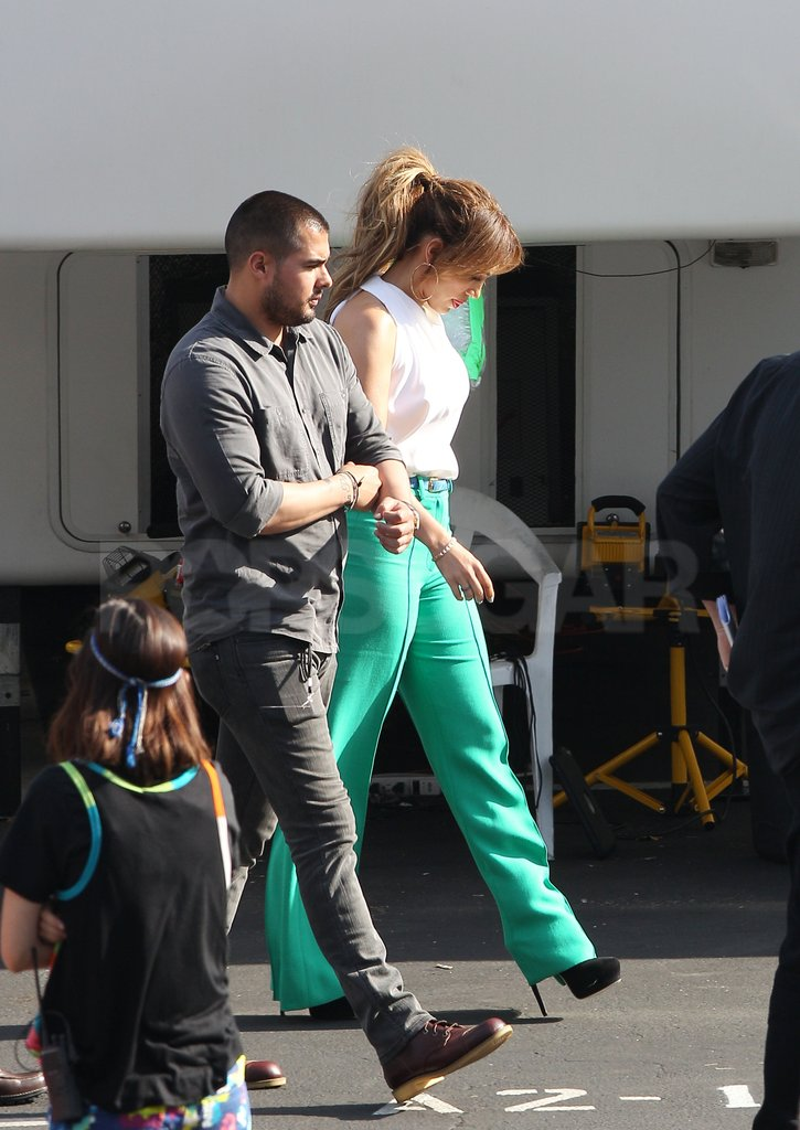 Jennifer Lopez wore black stilettos with her green pants.